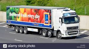 volvo freight trucks aldi supermarket delivery trailer and volvo truck on m25 motorway