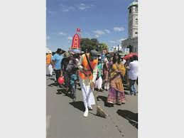 Festival of chariots brings Lord Krishna to devotees   Newcastle     Devotees sweep the way for the chariot
