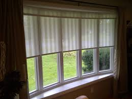 types of window treatments for bay windows curtains bow decor of window seat in greys with white plantation shutters on the bay they design in shades for