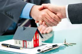 Estate agent shaking hands with customer after contract signature Mergers   Inquisitions