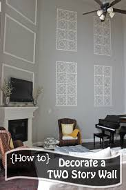Living Room Wall Photo Ideas How To Decorate A Two Story Wall What To Do With Those Crazy Tall