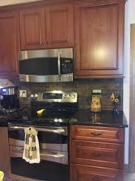cherry cabinets tan brown granite counter copper rust slate
