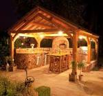 Outdoor Kitchens Ideas in Wooden Gazebo at Night with Lovely ...