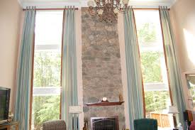 dressing bow windows a decorator s journey view from below of the willis family room windows i chose to do floor to ceiling panels to accentuate the height and size of the windows but also to