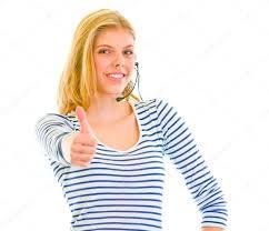 smiling beautiful teen in headset showing thumbs up u2014 stock