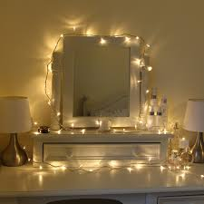 pretty warm bedroom fairylights around a dresser ideas for home