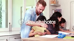 Parents Helping Children With Homework     Stock Video     Depositphotos Parents assisting children doing homework     Stock Video