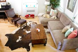 cowhide rug with leather couch for small living room arrangement