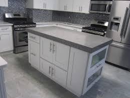 stunning grey and white kitchen design with grey tiled backsplash