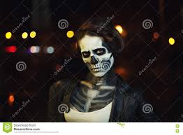 halloween city young woman with halloween face art street portrait night city