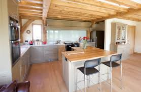 white gloss island with white granite top l shaped kitchen designs