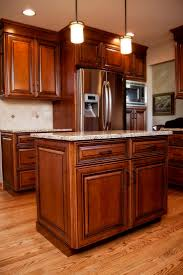 Maple Creek Kitchen Cabinets by Beautiful Maple Stained Cabinets With Black Glaze In This