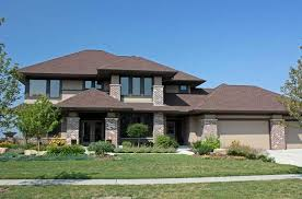 modern prairie style architecture with crumbling stone wall ideas