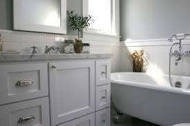 bathroom vanity marble countertop gray green walls subway tiles
