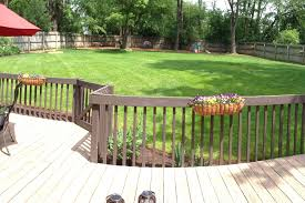 location of play set in large yard landscaping grass ivy