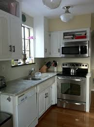 L Shaped Small Kitchen Designs Great Small Kitchen Design With Wooden Floor And White Cabinet