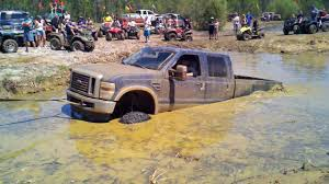 monster trucks in the mud videos watch as this massive ford mud truck gets pulled from the grasp of