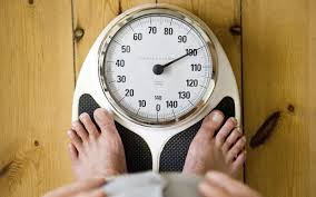 Man v Fat  The male weight loss regime that works   Telegraph man on scales