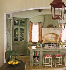 very small french country kitchen with marble top island and