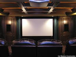 traditional home theater with a large movie projector screen