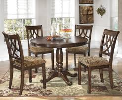 Dining Room Sets With Round Tables Leahlyn 5 Piece Cherry Finish Round Dining Table Set By Signature