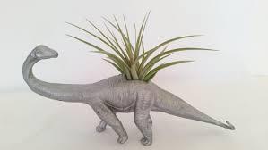 metallic silver dinosaur planter brontosaurus planter budding
