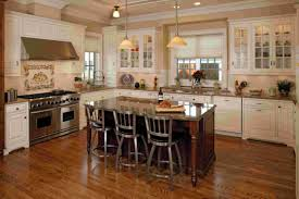 kitchen metallic barstools range hood white kitchen island