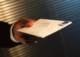 Man hading a letter to someone with a heart shaped stamp
