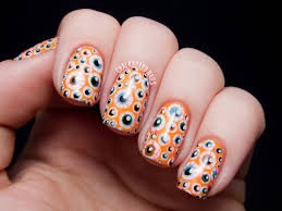 orange and white ghost face halloween nail art