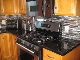 granite countertop cherry cabinets in kitchen backsplash with