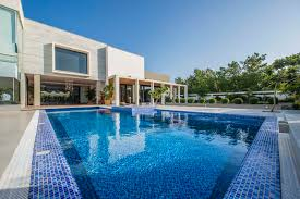 ali arshad associates modern elevation with a luxurious pool