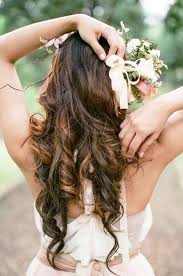 Bride     s long down curls bridal hair Toni Kami Wedding Hairstyles         Wedding hairstyle ideas flower Pinterest