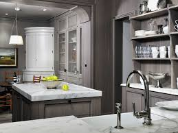 grey wash kitchen cabinets with carrera marble counter tops