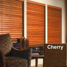 decorating white wall with brown faux wood blinds plus dark brown
