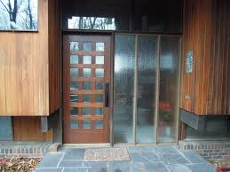 mesmerizing wooden modern front door with clear glass lite and