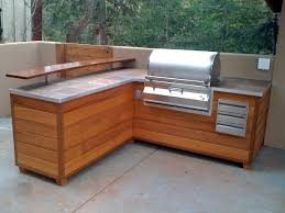 an outdoor barbeque island that looks like wooden furniture fine