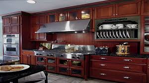 decorating brown wooden kraftmaid cabinets with black countertop great and recommended kraftmaid cabinets for more beautiful kitchen decor ideas brown wooden kraftmaid cabinets