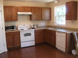 popular kitchen cabinet colors with island also granite countertop
