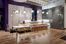 a contemporary kitchen shines with high gloss cabinetry beck