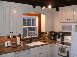 White Kitchen Cabinets With Black Granite Countertops by Cherry Wood Nutmeg Amesbury Door Pictures Of Kitchens With White
