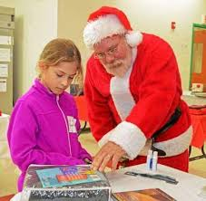 YMCA program offers children a      safe haven      after school   Greater     Greater West Chester Chamber of Commerce Natalie Gonzalez  left  shops with Santa Claus in the Believe  amp  Achieve after school program Holiday Shop at Oscar Lasko YMCA Youth Program Center in West