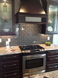 ice gray glass subway tile dark brown cabinets subway tile