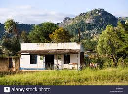 small house shop beside the road at dedza malawi africa stock