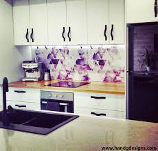 our colourful geometric kitchen splashback under lights wallpaper