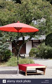 red umbrella in garden for green tea ceremony japanese style