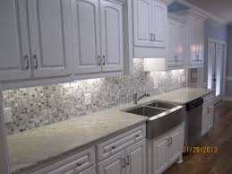 image result for cream cabinets grey glass backsplash island nice white galley kitchen decors added cabinets finished also steel gray granite for backsplash countertops installations ideas