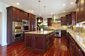 cherry wood cabinets a must granite counter tops and an island