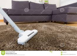 carpet with vacuum cleaner in living room stock images image