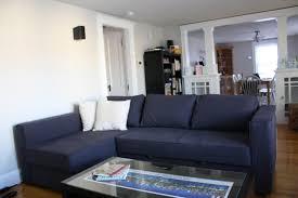 minimalist living room decor with dark gray leather sofa with