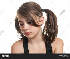 beautiful teen with two pigtails in black top having a sad